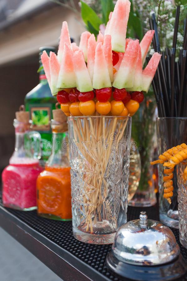 Fruit vegetarian canape at wooden skewers with watermelon and berries. Vegan food on event royalty free stock image