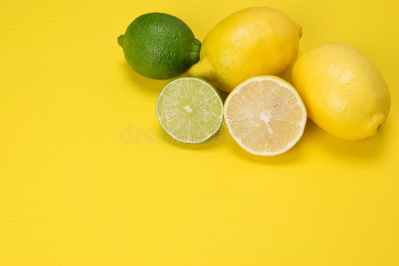 Fruit with vitamin C chopped and lie on a yellow background, lime and lemons. Fruit with vitamin C chopped and lie on yellow background, lime lemons royalty free stock photography