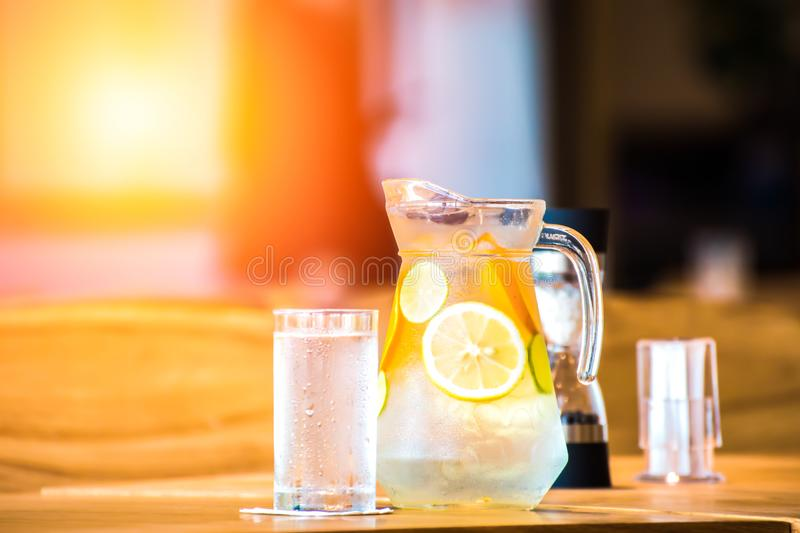 The fruit in the water and ice is on the table stock photography
