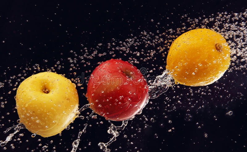 Fruit in a water jet. stock images