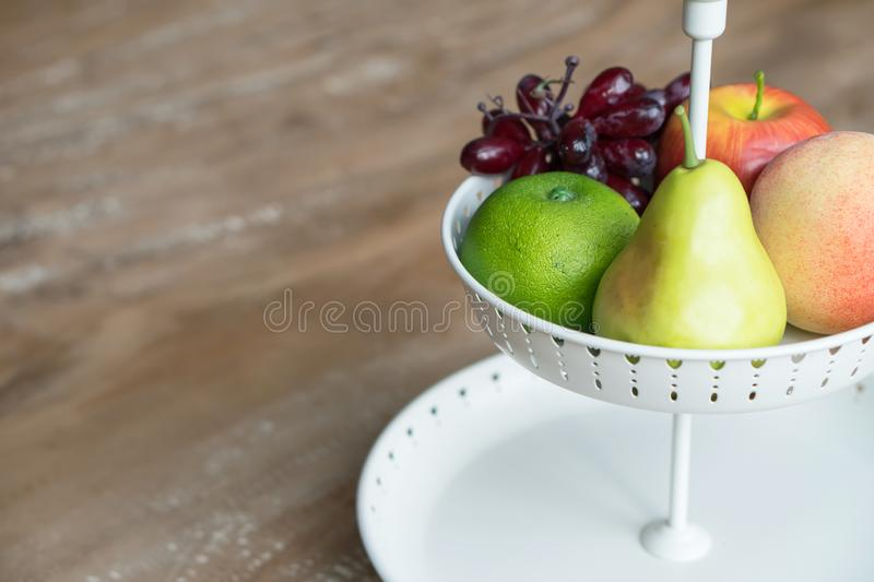 Fruit in white wire basket. Fruits in white wire basket royalty free stock images