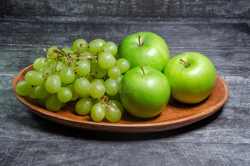 Fruit on a wooden bowl royalty free stock images