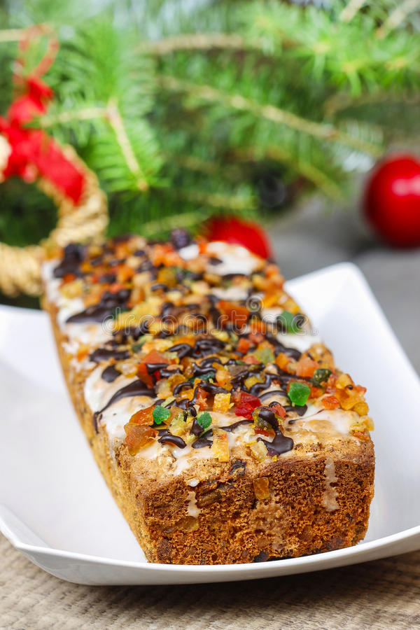 Fruitcake in christmas setting royalty free stock photography