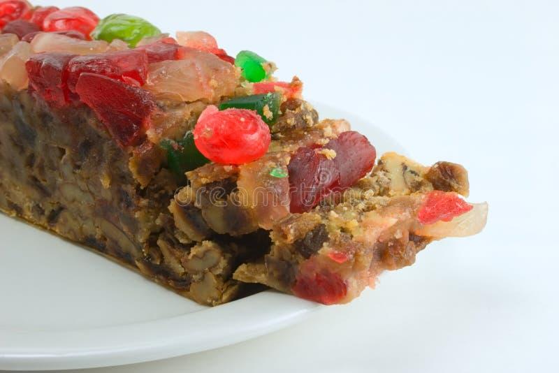 Fruitcake en una placa fotografía de archivo libre de regalías