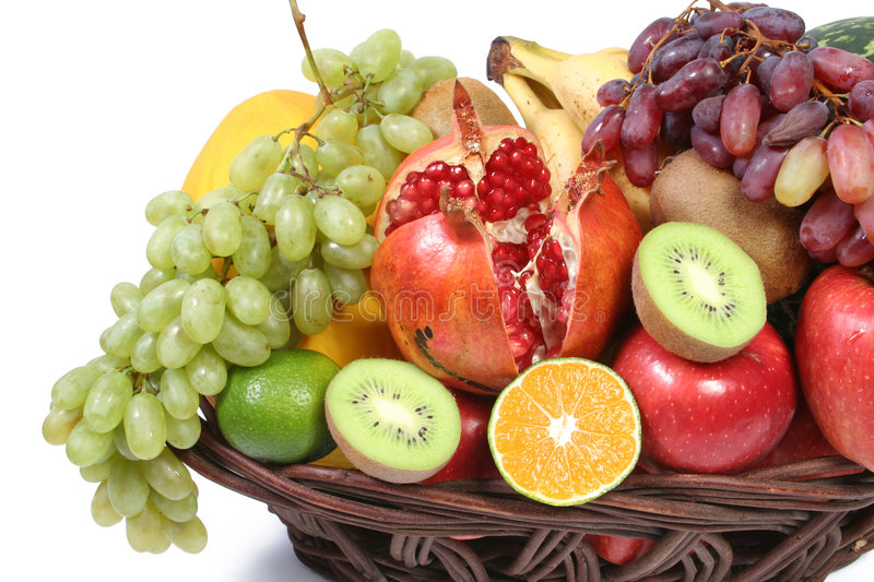 Fruits. Fresh fruits in basket. summer and winter. isolated on white royalty free stock photos