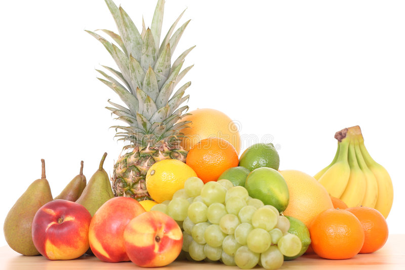 Fruits. Lots of various fresh fruits isolated on white stock images
