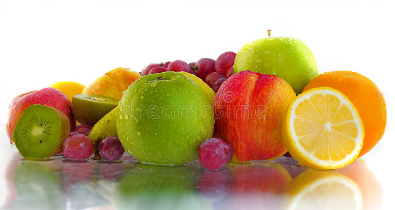 Fruits. Delicious fresh fruits on white background and reflection stock photos