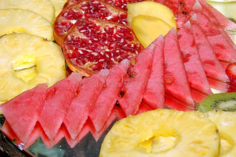 Fruits. Pinneaple, watermellon, kiwi and other fruits royalty free stock photo