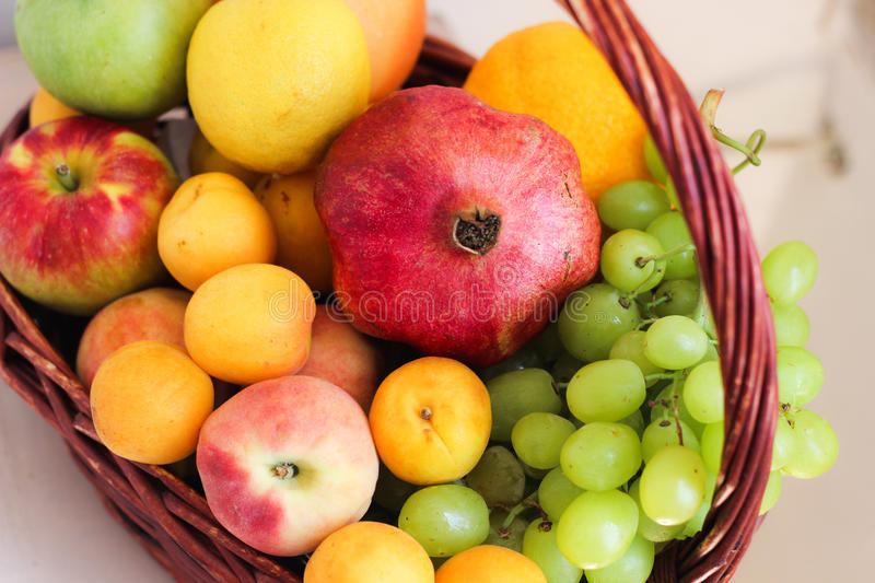 Fruits in basket royalty free stock photos