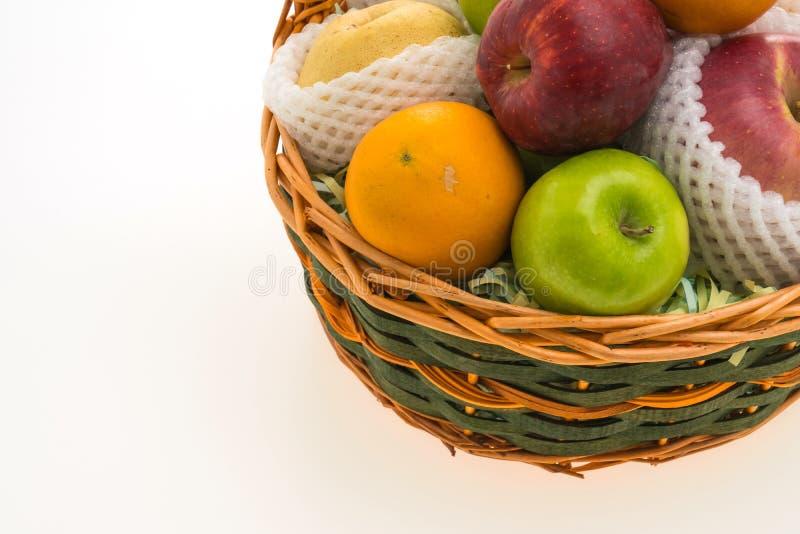 Fruits basket. Isolated on white background - Healthy food style royalty free stock image