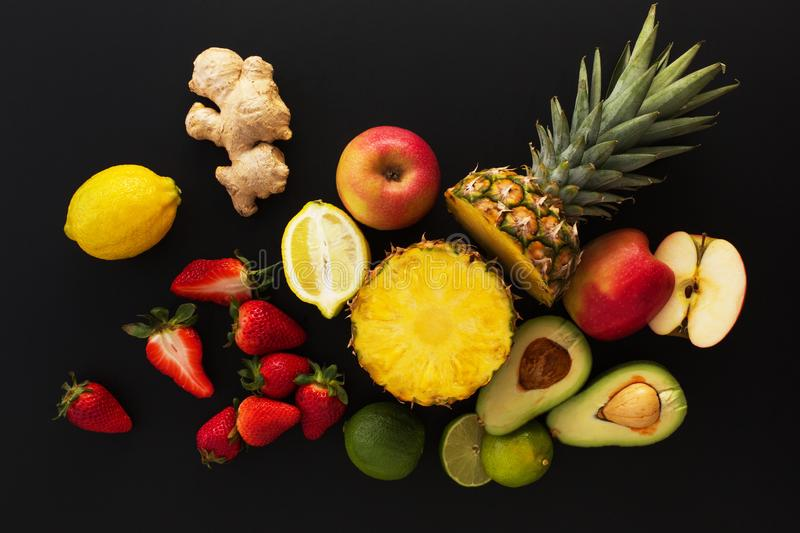 Fruits on black background. Healthy eating wallpaper.  stock image