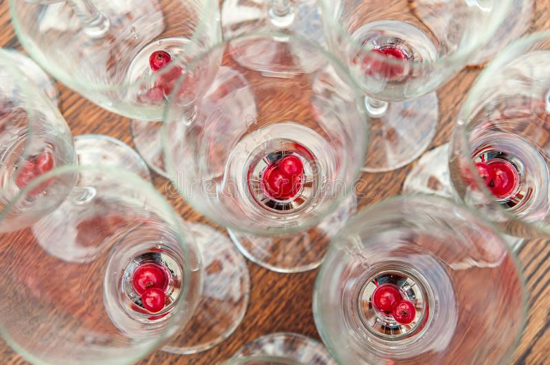 Fruits on the bottom of sparkling wine glasses stock image