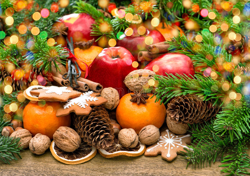 Fruits, christmas cookies and spices with wonderful lights royalty free stock photography