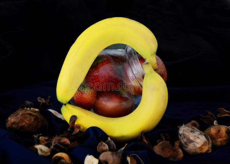Fruits in a Container in Dark Food Mode. Bananas Strawberries, nectarines and more in a Container, Dark Food Mode in Beautifull presentation royalty free stock photo