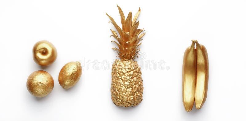 Fruits d'or dans la rang photo libre de droits