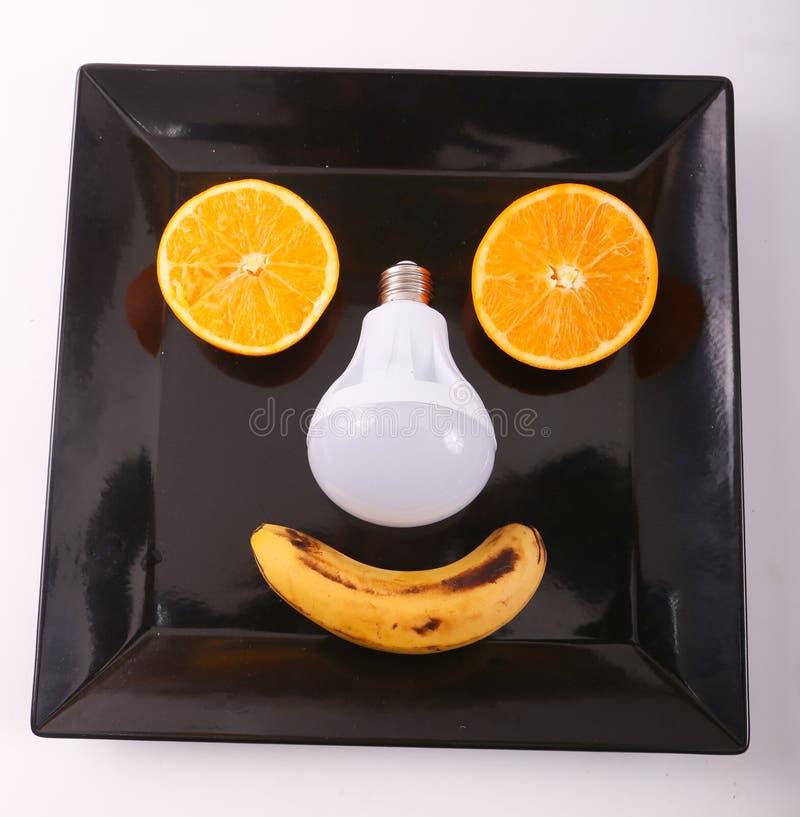 Fruits de variété d'idée avec la lampe comme visage photographie stock libre de droits