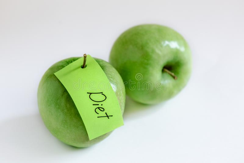 Two green apples note. Fruits for diet, two green apples, green note, health nutrition stock images