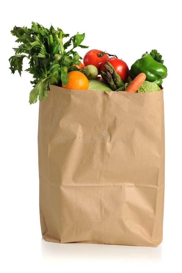 Fruits et légumes dans le sac d'épicerie photographie stock libre de droits