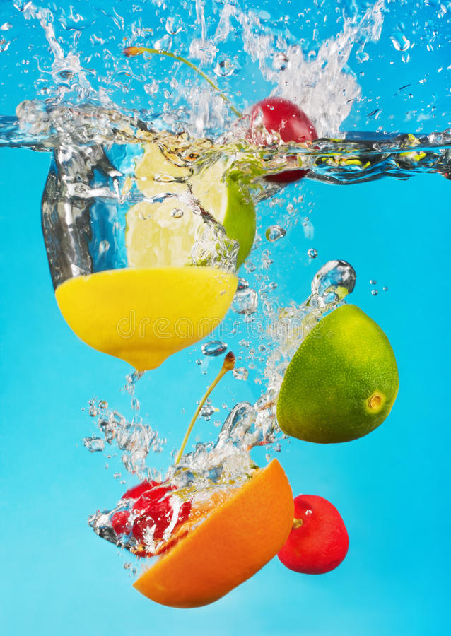 Fruits fall deeply under water royalty free stock image