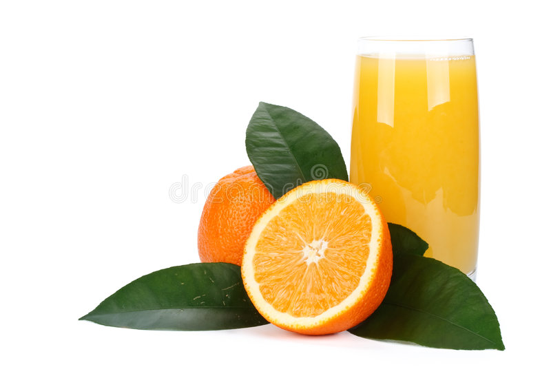 Fruits with green leaves and glass of juice stock photo