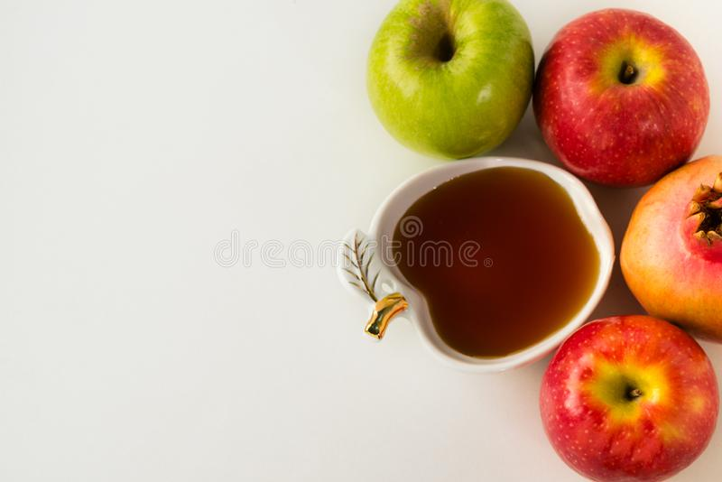 Rosh hashanah jewish New Year holiday concept. Traditional symbols on wooden white table. royalty free stock image
