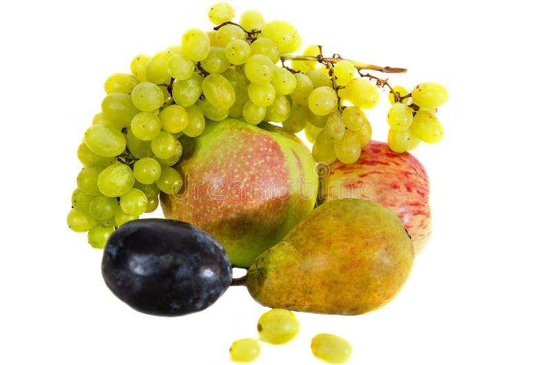 Fruits isolated on a white background. Close-up. Grapes, apple, pear, plum. Close-up. stock image