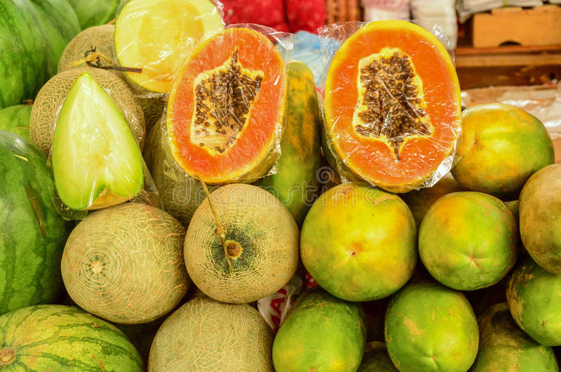 Fruits, Java, Indonesia. Papaya, watermelon and honeydew for sale in a Java Market royalty free stock images