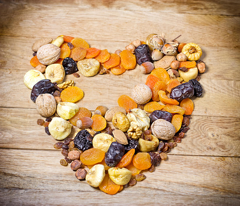 Fruits that keeps your heart - healthy food. Fruits that keeps your heart - organic dried fruits stock image