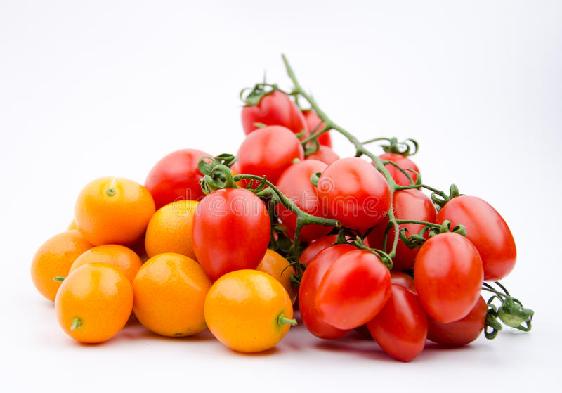 Fruits: little orange and cherry tomatoes royalty free stock photos