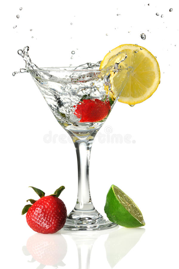 Fruits and Martini Glass. With liquid splashing isolated over white background stock photos