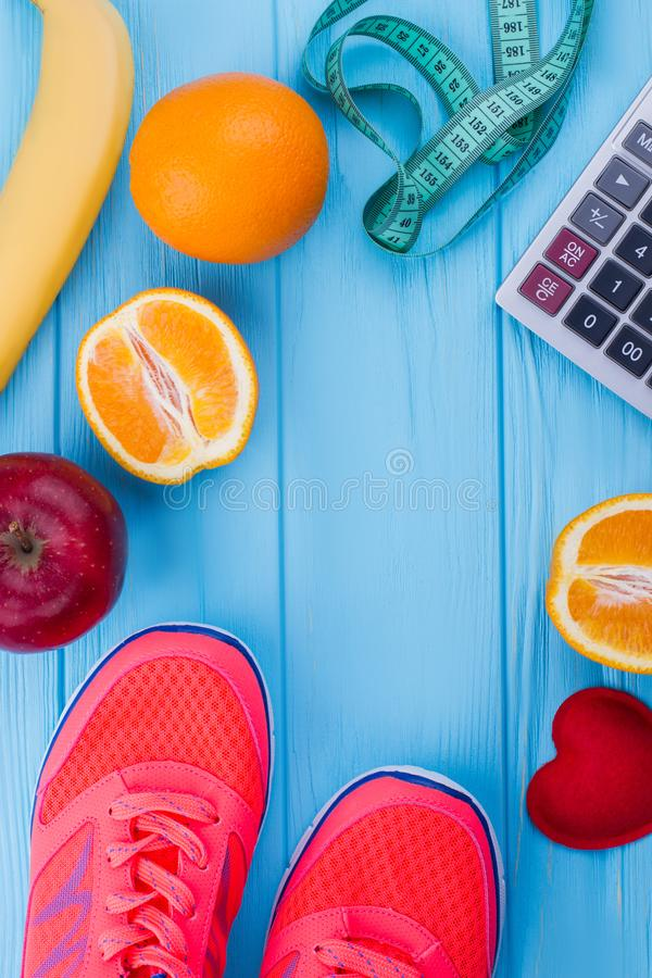 Fruits, measuring tape and running shoes. stock images