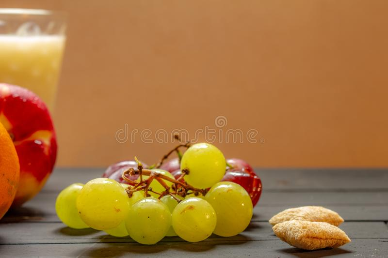 Fruits and milk on a rustic wooden board. Healthy breakfast concept royalty free stock photography