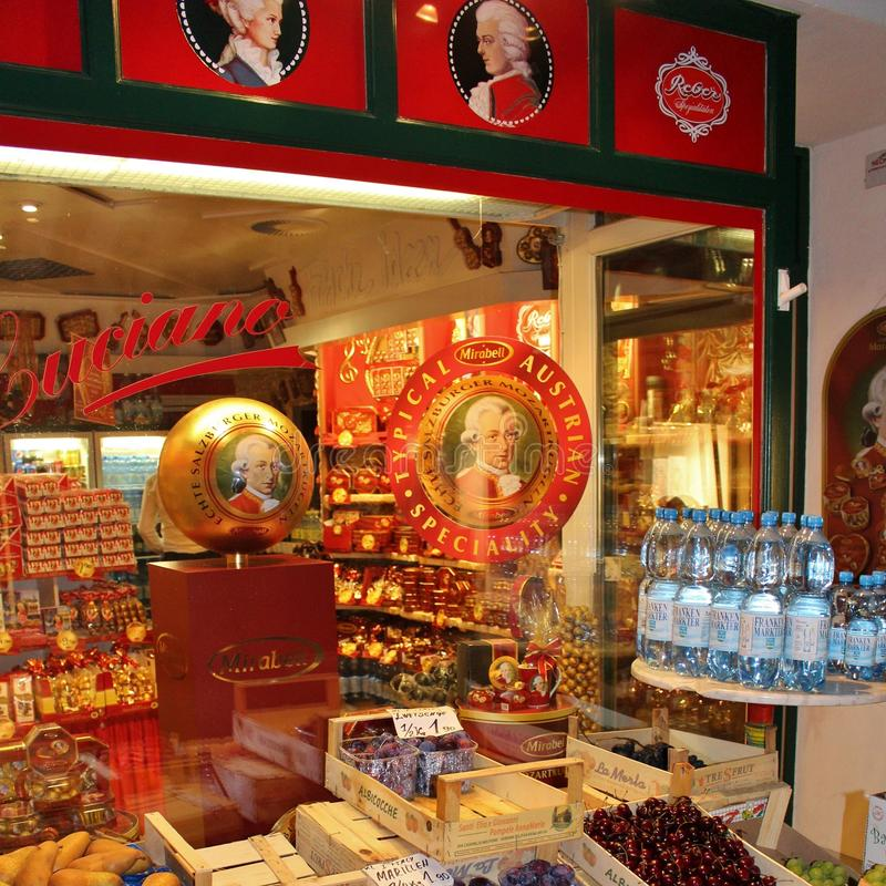 Fruits and Mozartkugeln in Salzburg. Salzburg is a city in Austria, which is known for its baroque architecture, history, and as a gateway to the Alps. The Old royalty free stock image