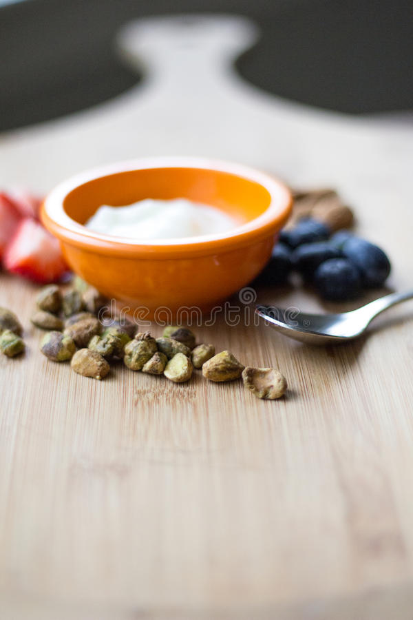 Fruits and Nuts on a Cutting Board royalty free stock photography