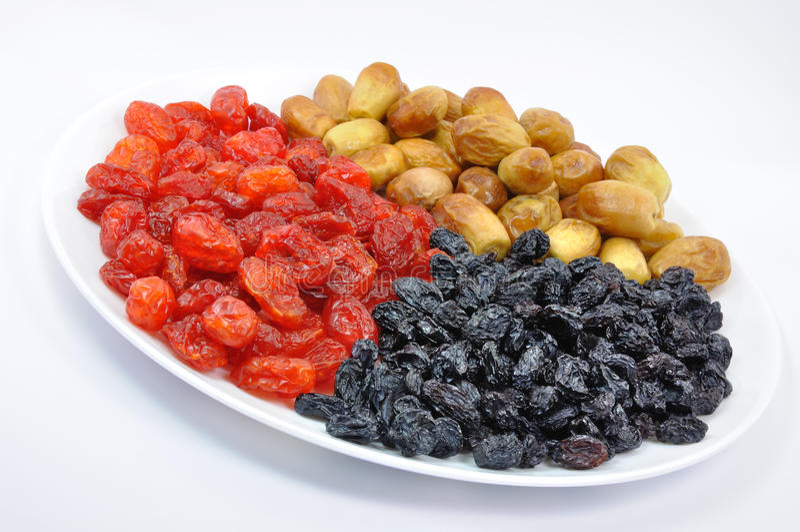 Fruits secs de la plaque blanche photos libres de droits