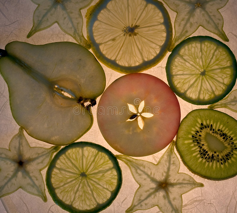 Fruits series (2). Various fruits, sliced and arranged - Fruits series part 2 stock images
