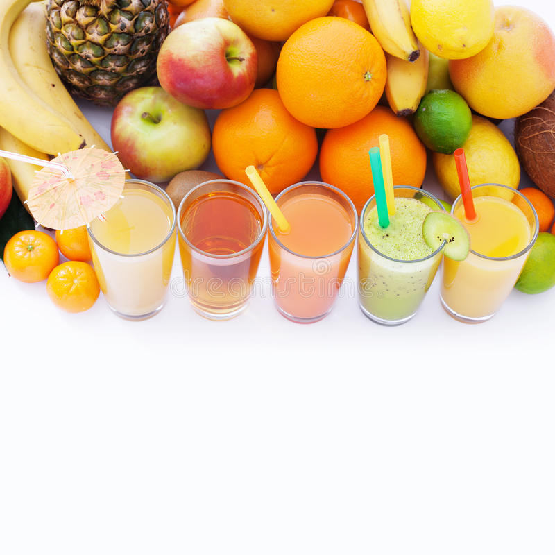 Fruits smoothies, summer cool drinks top view macro royalty free stock images