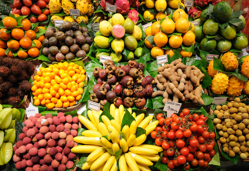 Fruits stand in at market, Barcelona. Fruits stand in La Boqueria market, Barcelona Spain royalty free stock photo
