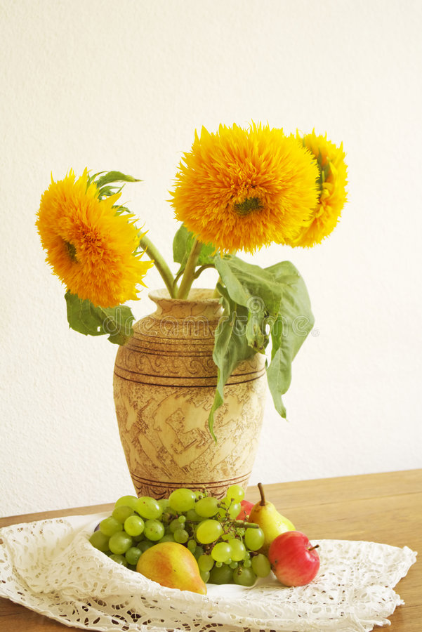 Fruits and sunflowers royalty free stock image