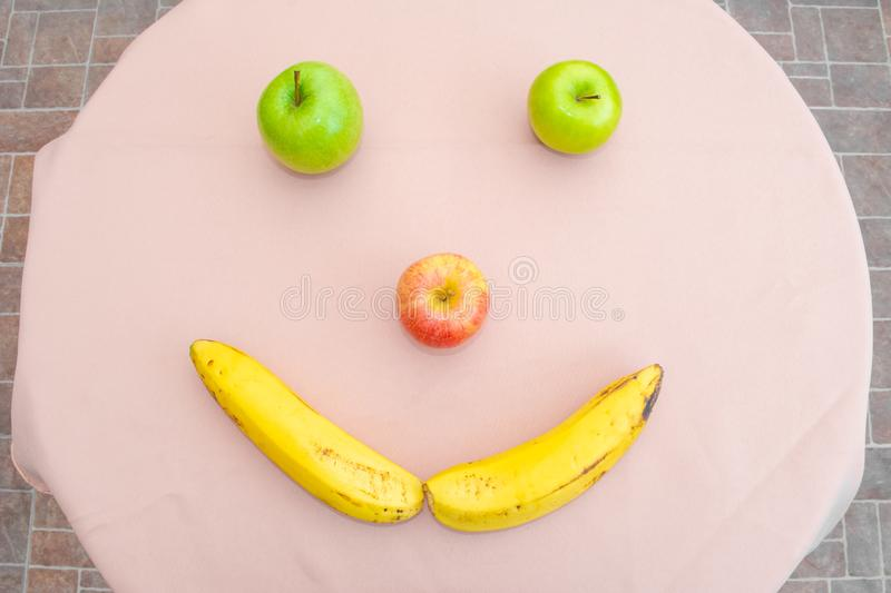 Fruits on the table. Happy face royalty free stock photography