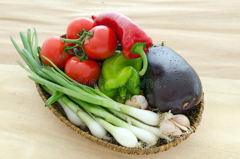 Fruits and vegetables. Basket with potatoes and green beans with added cucumber green pepper and a tomato and onions stock images