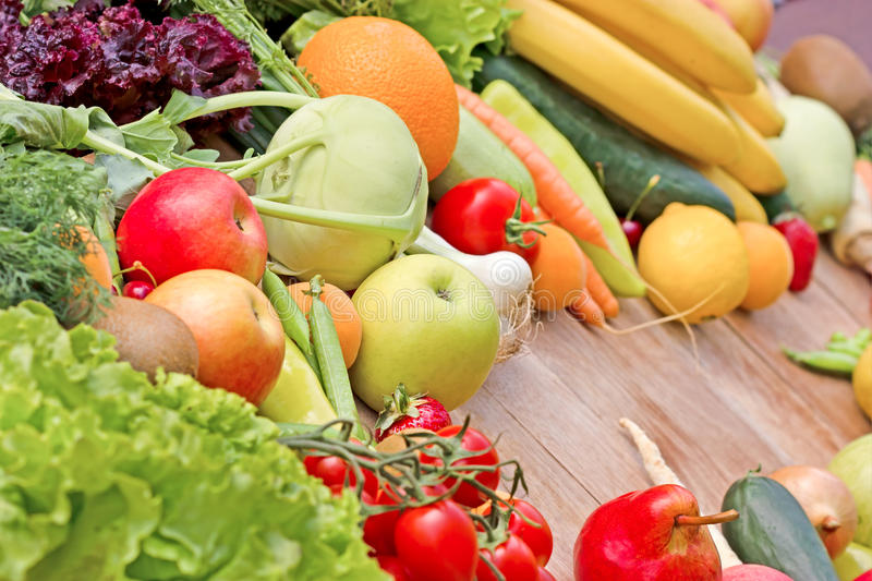 Fruits and vegetables. The abundance of fruits and vegetables stock photo