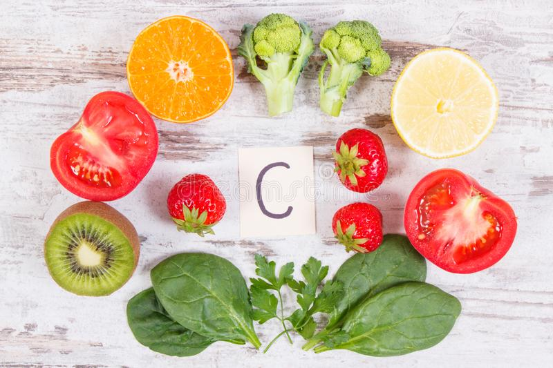 Fruits and vegetables as sources vitamin C, dietary fiber and minerals, strengthening immunity concept. Fruits and vegetables as sources of minerals containing royalty free stock photos