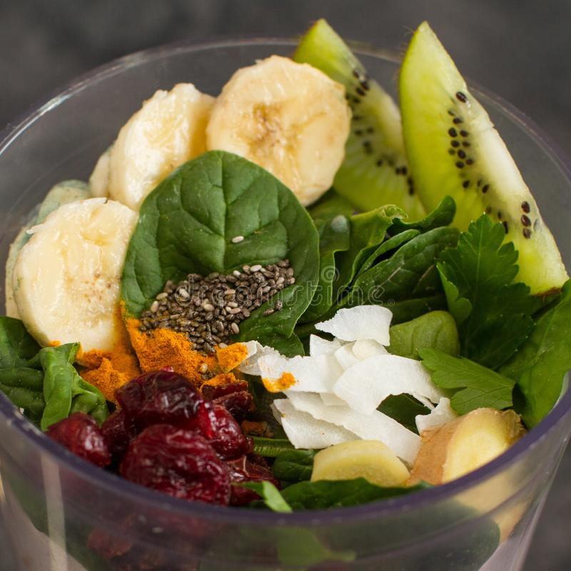 Fruits and vegetables in a blender for raw healthy smoothies royalty free stock image