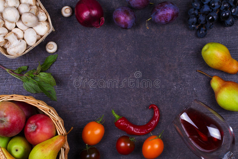 Fruits and vegetables on dark wooden background royalty free stock images