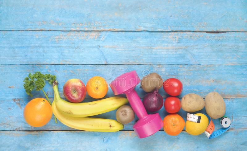 Fruits,vegetables,dumbbells, healthy food, diet royalty free stock photography
