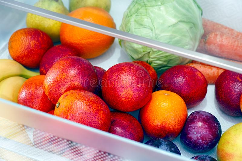 Fruits and vegetables in the fridge drawer. Close up stock photography
