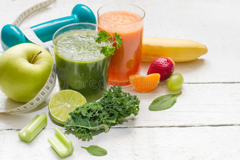 Fruits, vegetables, juice, smoothie and dumbell health diet and fitness royalty free stock photography