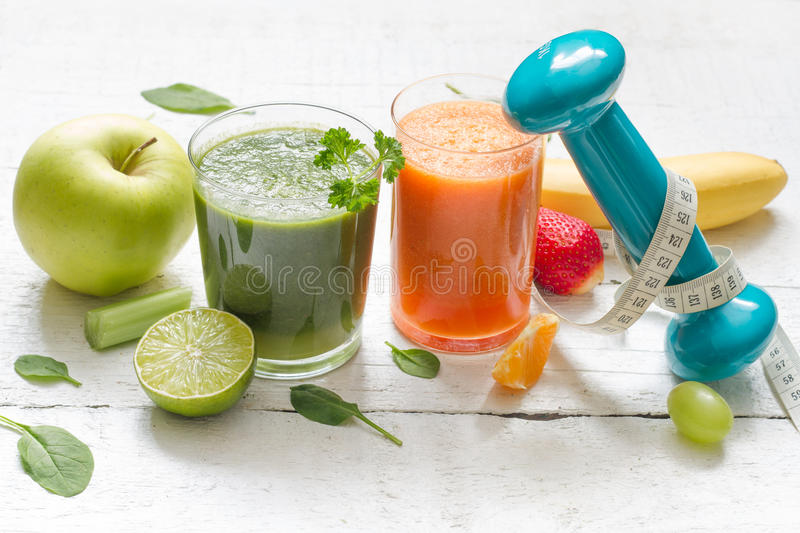 Fruits, vegetables, juice, smoothie and dumbell health diet and fitness royalty free stock photos