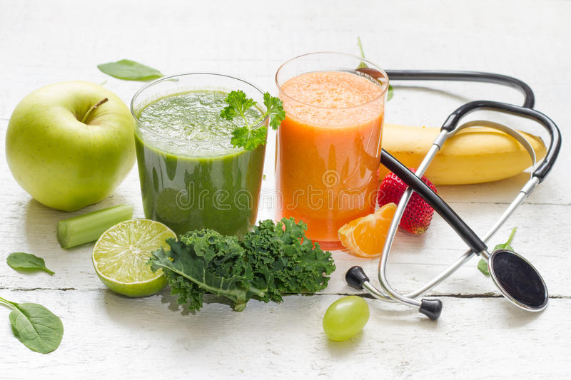 Fruits, vegetables, juice, smoothie and stethoscope stock photography